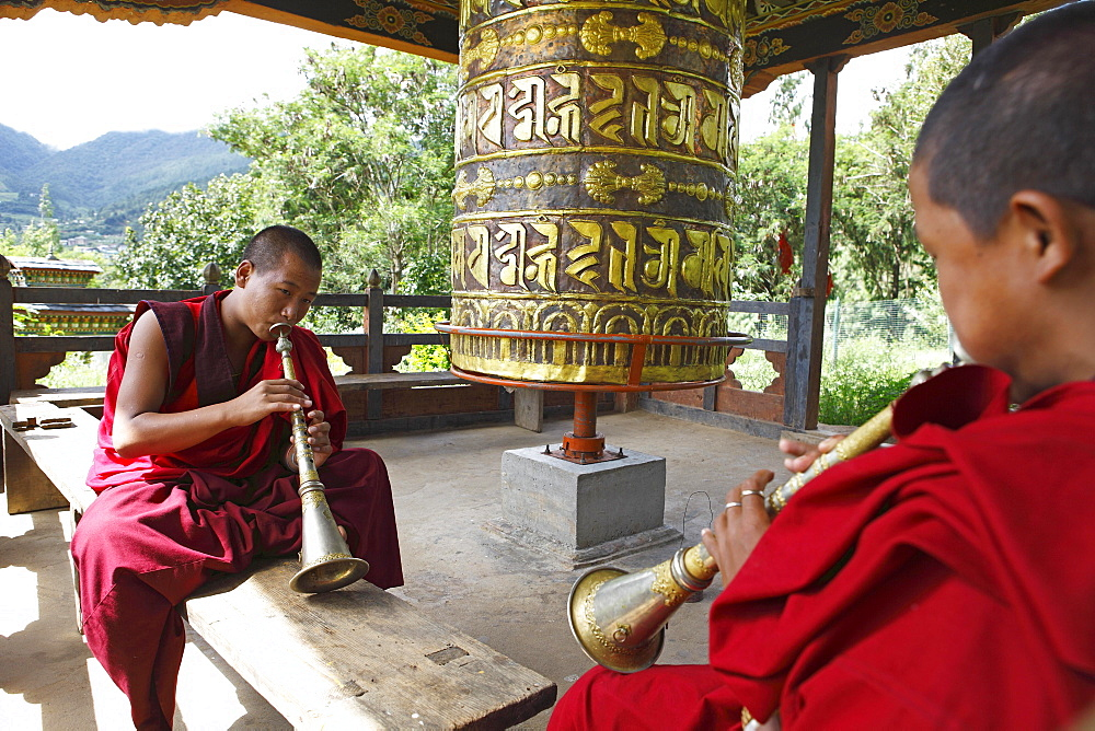 Monks playing Gyalings, Chimi Temple, Punakha District, Bhutan, Asia