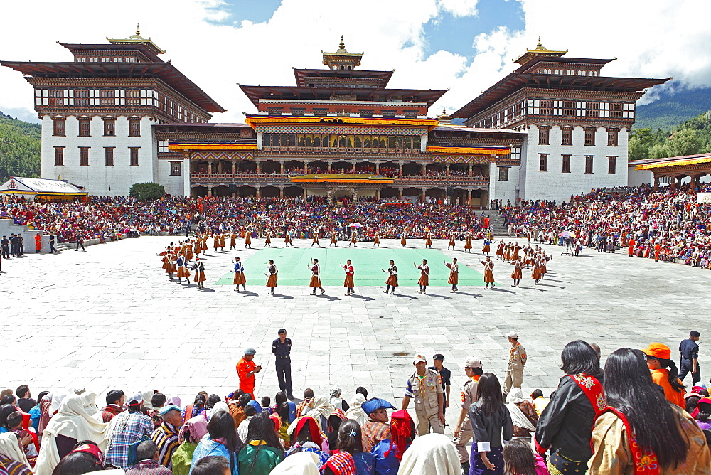 Dancers and spectators at the Tashichho Dzong monastery festival, Thimphu, Bhutan, Asia