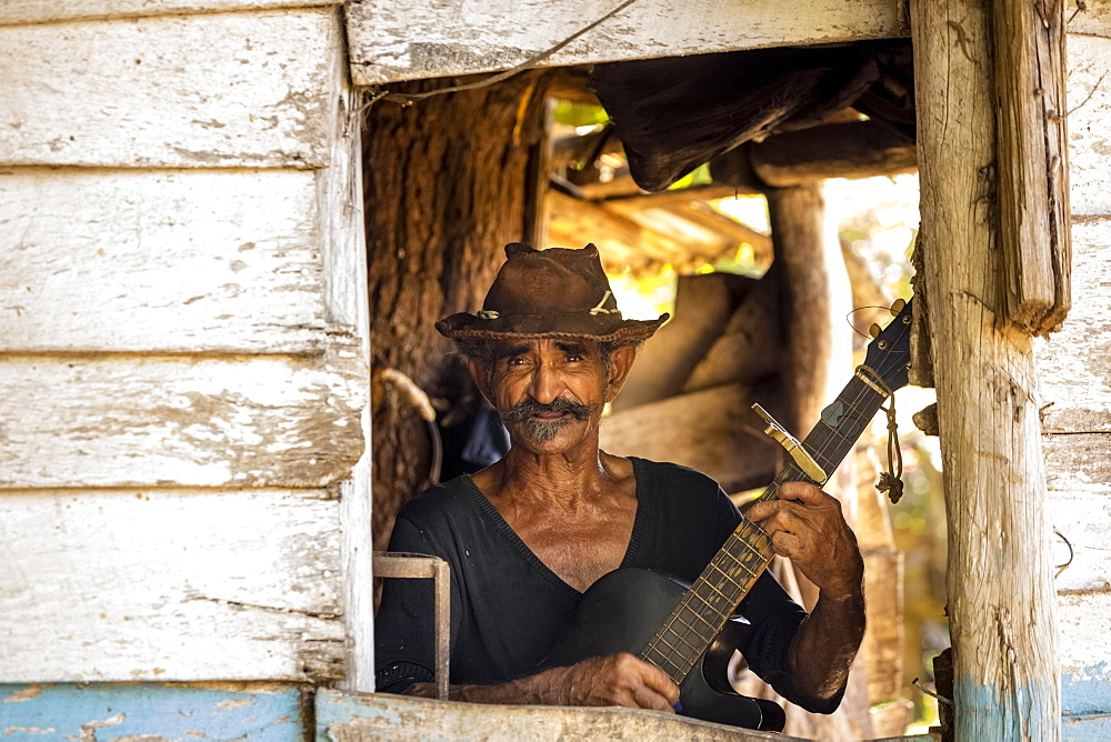 Sugar cane farmer playing the guitar, Valle de los Ingenios, Trinidad, Sancti Spiritus Province, Cuba, Central America