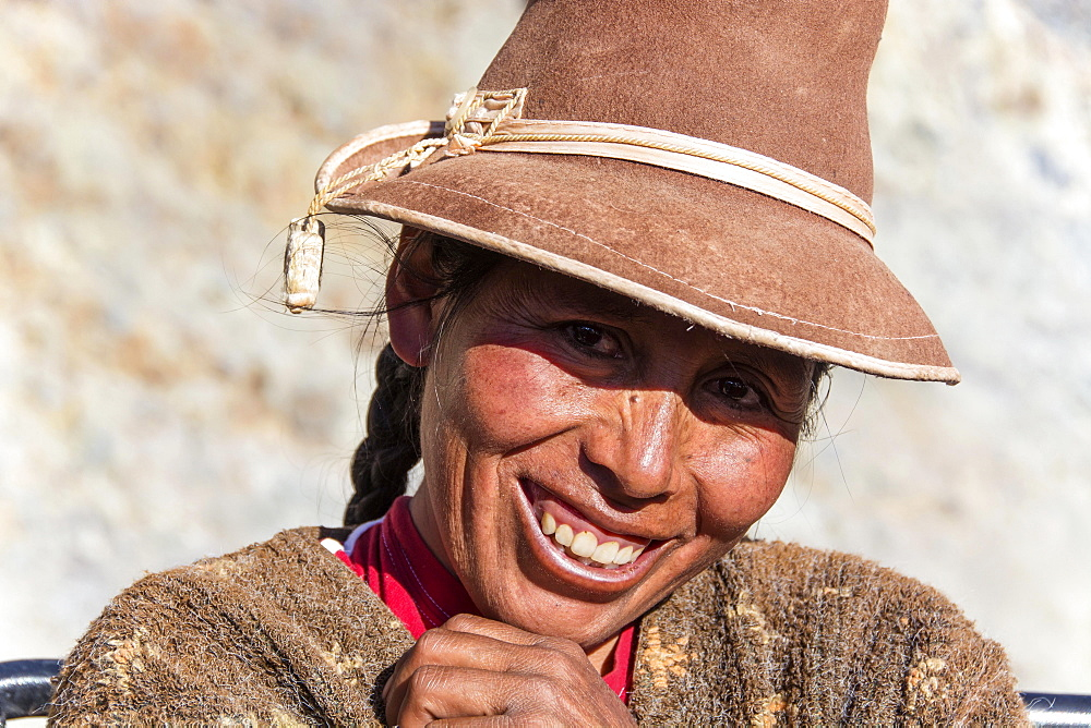Indigenous woman with hat, laughing, Cusco, Peru, South America
