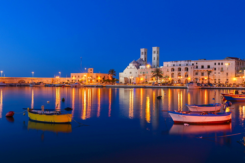 Blue Hour, dusk, fishing boats, harbour, historic centre, with the Romanesque Duomo Vecchio, old cathedral, San Corrado, Molfetta, Bari Province, Apulia, Italy, Europe