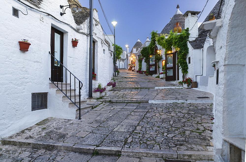 Dusk, shop, trulli traditional round houses, Rione Monti, Alberobello, Valle d'Itria, Trulli Valley, Apulia, Italy, Europe