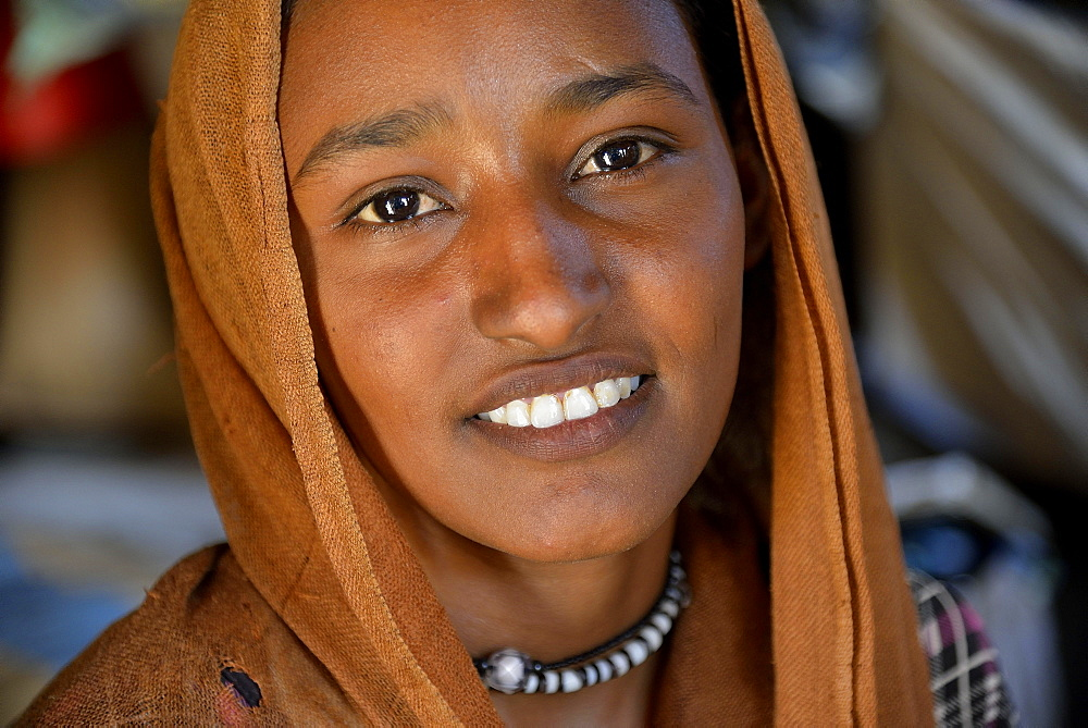 Young girl from the nomadic tribe of the Bush Arian with headgear, Portrait, Bayuda Desert, in Karima, Nubia, Northern Sudan