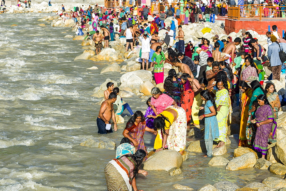 Pilgrims from all over India come to the banks of the river Ganges to have their holy dip into the water, Gangotri, Uttarakhand, India, Asia
