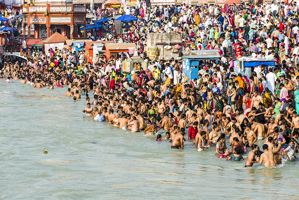 Masses of pilgrims are gathering for bathing at Harki Pauri Ghat at the holy river Ganges, Haridwar, Uttarakhand, India, Asia