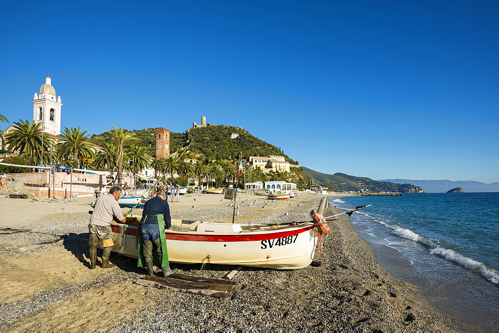 Fishermen with a fishing boat on the beach of Noli, Riviera di Ponente, Liguria, Italy, Europe