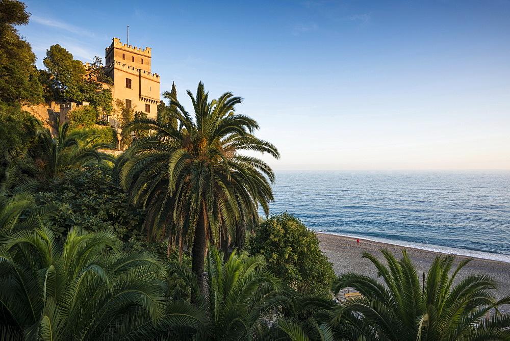 Villa with palm trees by the sea, Finale Ligure, Riviera di Ponente, Liguria, Italy, Europe