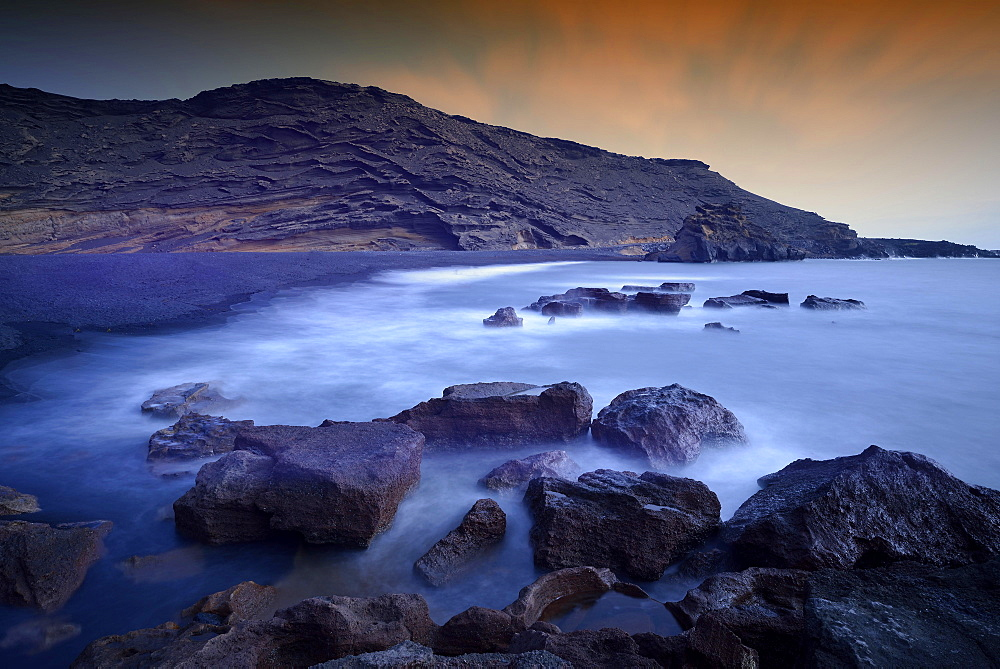 Surf at the lava beach, evening light, Charco de los Clicos in El Golfo, Lanzarote, Canary Islands, Spain, Europe
