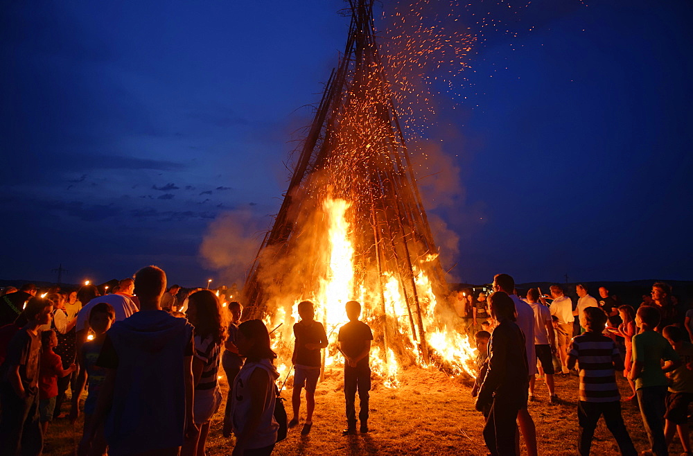 People standing around a Sonnwendfeuer bonfire, Johannifeuer, Upper Bavaria, Bavaria, Germany, Europe