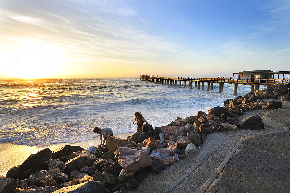 Sunset on the 325 meter long wooden jetty in Swakopmund, Namibia, Africa