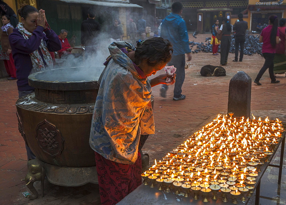 Buddhists in prayer at dawn, Boudhanath, Kathmandu, Nepal, Asia