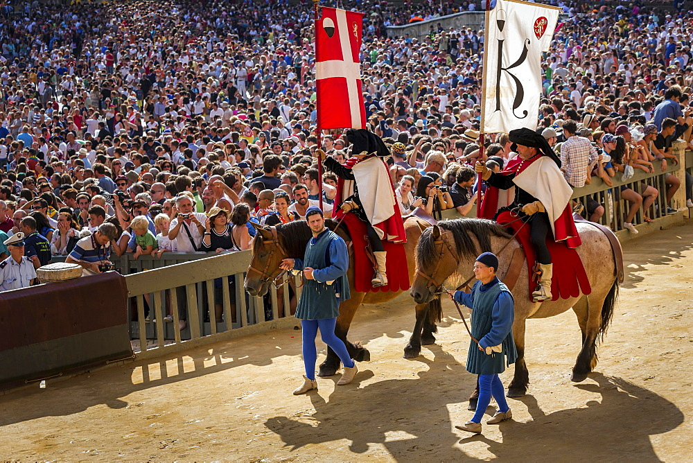 Parade of flag carriers on horses at the historical parade before the Palio di Siena horse race, Siena, Tuscany, Italy, Europe