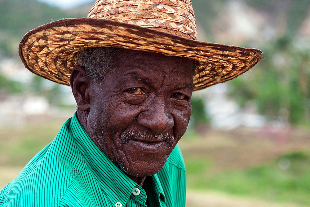 Cuban man wearing a straw hat, portrait, near Santiago de Cuba, Cuba, Central America