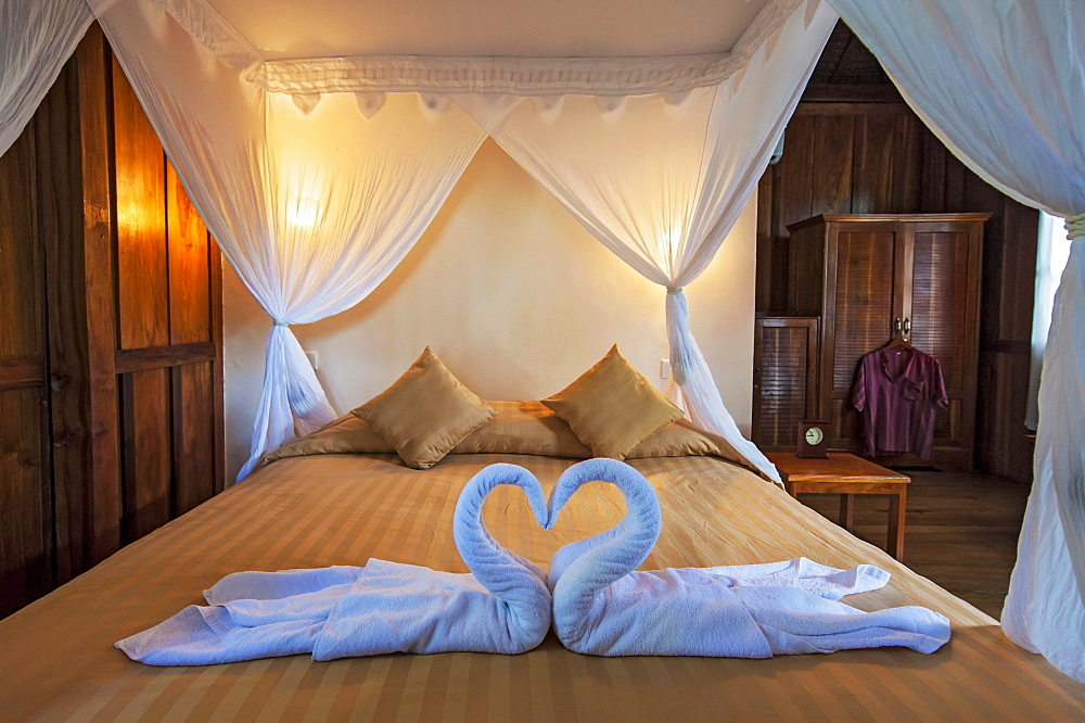 Bed in Palm Bungalow, Wakatobi Dive Resort, Sulawesi, Indonesia, Asia