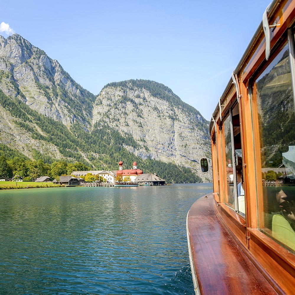 View from a passenger boat on Lake Konigsee, in the back boat landing stage St. Bartholoma and Watzmann massif, mountain landscape, Berchtesgaden National Park, Berchtesgadener Land, Upper Bavaria, Bavaria, Germany, Europe