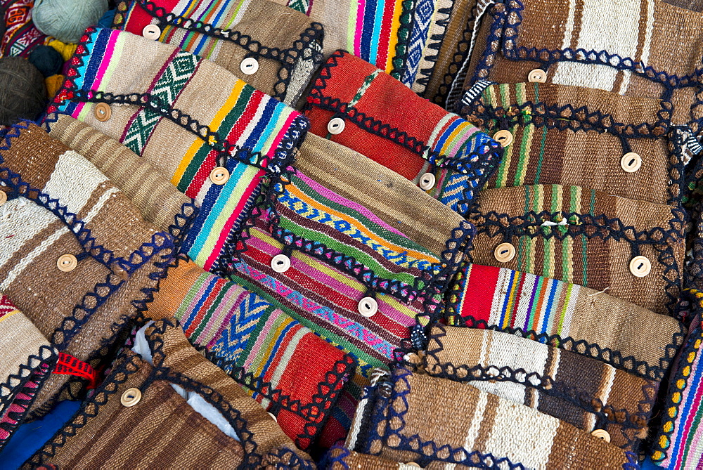 Handmade bags with the traditional patterns of the Quechua Indians are displayed for sale, Cinchero, Urubamba Valley, Peru, South America