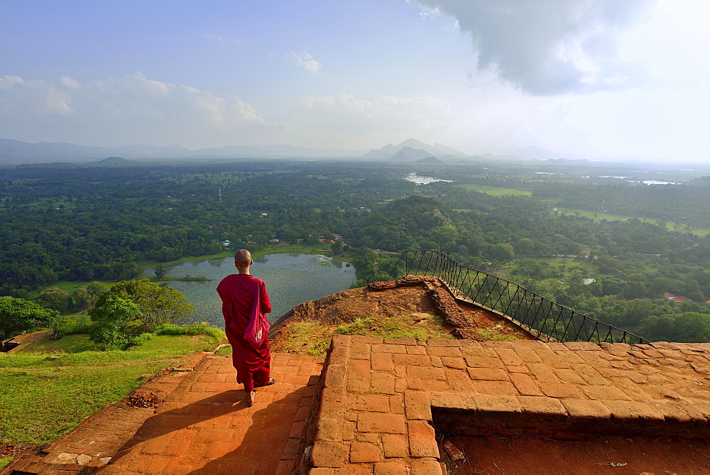 Buddhist nun enjoying the view from the ruins of the fortress on the Lion Rock, Sigiriya, UNESCO World Heritage Site, Sigiriya, Central Province, Sri Lanka, Asia