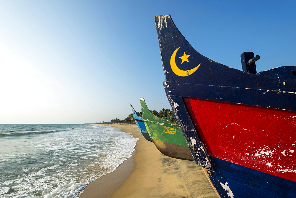 Colorful fishing boats on the beach, Varkala, Kerala, India, Asia
