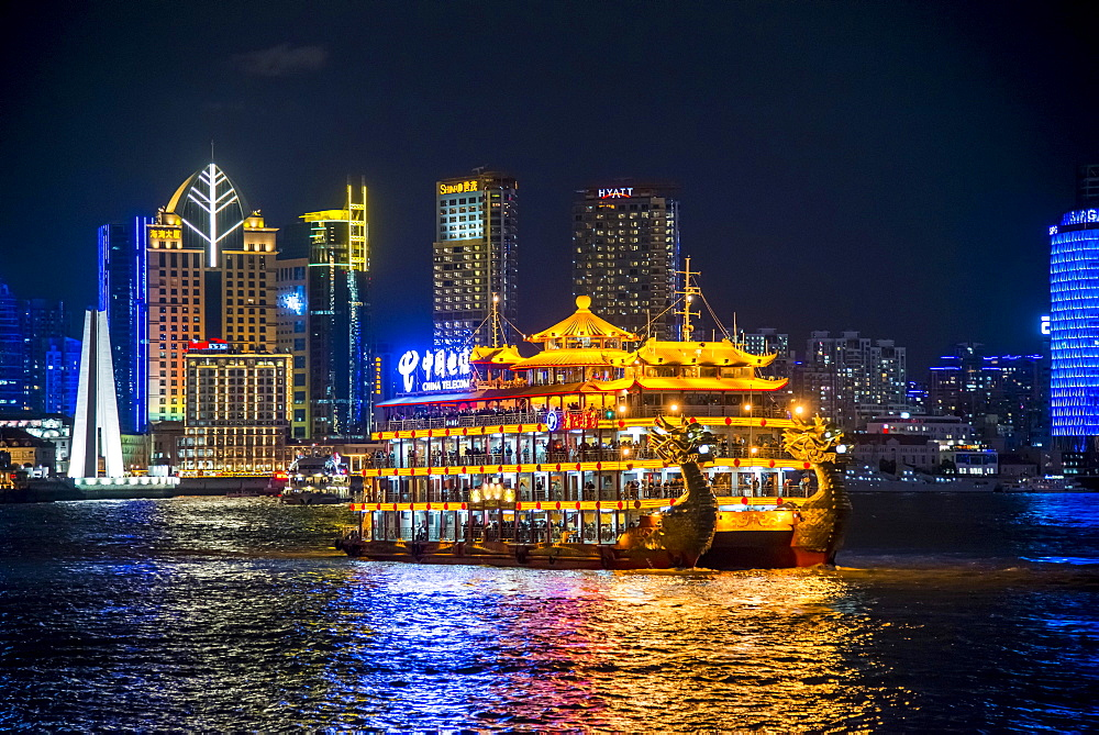 Illuminated dragon boat, pleasure boat on Huangpo, from The Bund, Hyatt at The Bund at the back, at night, Shanghai, China, Asia