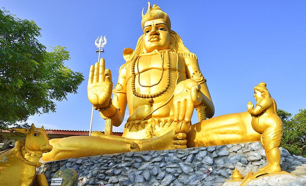 Golden Shiva statue in Hindu Shiva temple Koneswaram, Trincomalee, Eastern Province, Sri Lanka, Asia