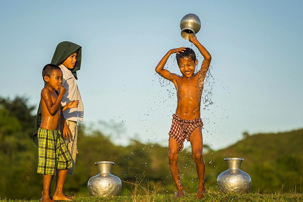 Boy washing himself, Mrauk U, Sittwe Division, Rakhine State, Myanmar, Asia