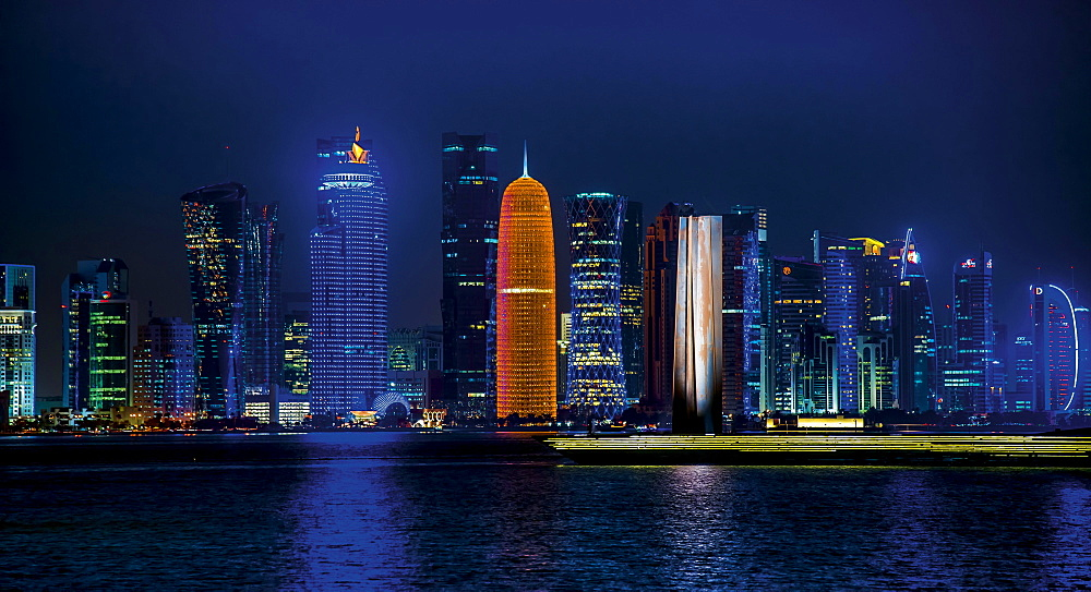 Night scene of the skyline of Doha with Al Bidda Tower, World Trade Center, Palm Tower 1 and 2, Burj Qatar Tower, Doha Corniche, Doha, Qatar, Asia