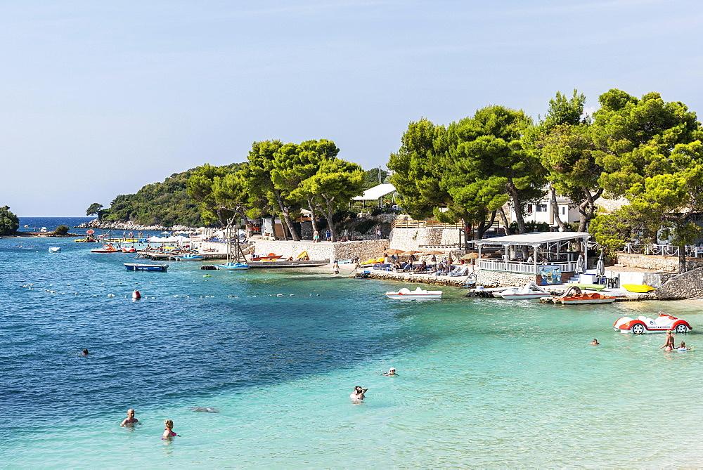 Tourists at the beach, Bay, Resort, Ksamil, Saranda, Ionian Sea, Albania, Europe