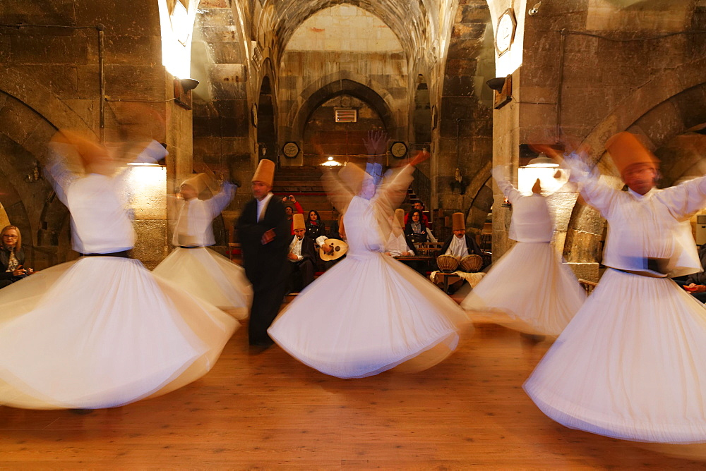 Whirling Dervishes of the Mevlevi Order, Sema ceremony, Saruhan Caravanserai, Sarihan, near Avanos, Cappadocia, Central Anatolia Region, Anatolia, Turkey, Asia