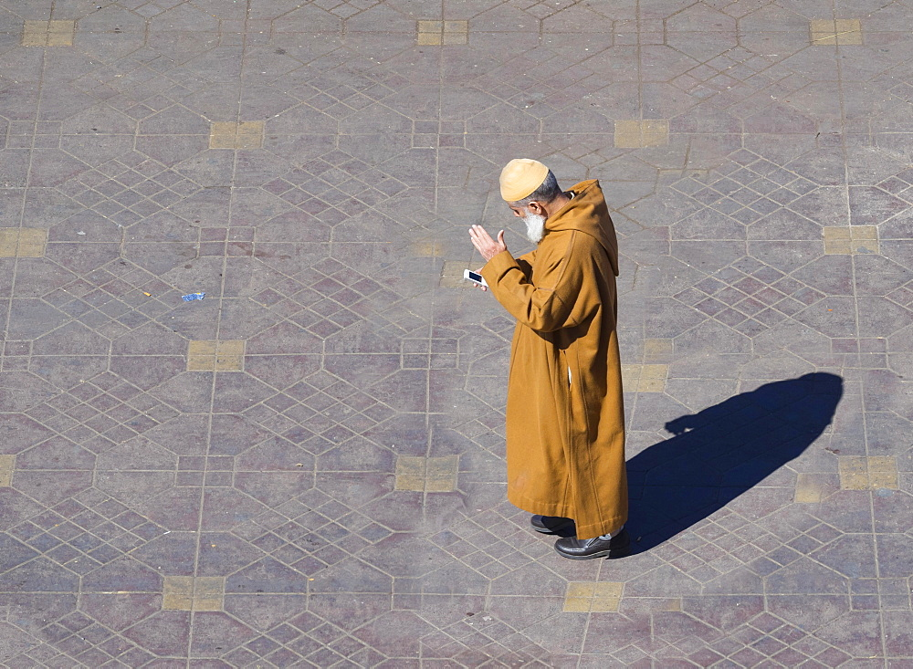 Berber man, Muslim man with a mobile phone, Djemaa el Fna square, historic Medina, Marrakech, Marrakech-Tensift-El Haouz, Morocco, Africa