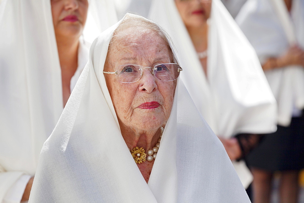 Mature woman taking part in the Easter procession in the historic centre of Vegueta, Las Palmas, Gran Canaria, Canary Islands, Spain, Europe - 832-383134
