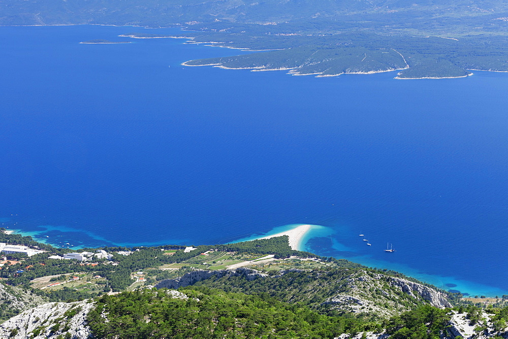 View from Vidova Gora on the town of Bol, Zlatni Rat or Golden Horn and the island of Hvar at the back, island of Brac, Dalmatia, Croatia, Europe