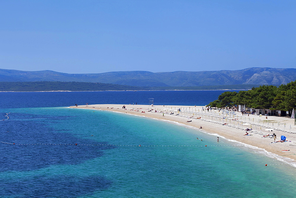 Beach at Zlatni Rat or Golden Horn, island of Hvar at the back, Bol, Island of Brac, Dalmatia, Croatia, Europe
