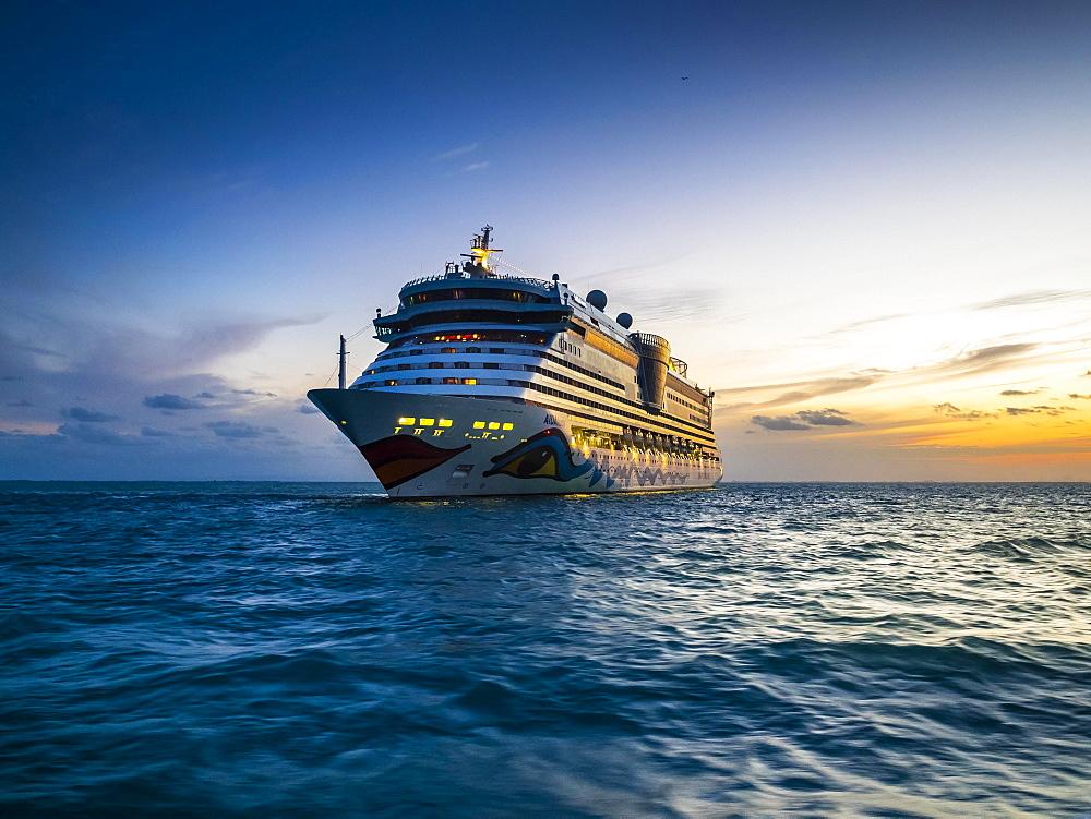 Cruise ship Aidaluna off the coast, sunset, Belize, Central America