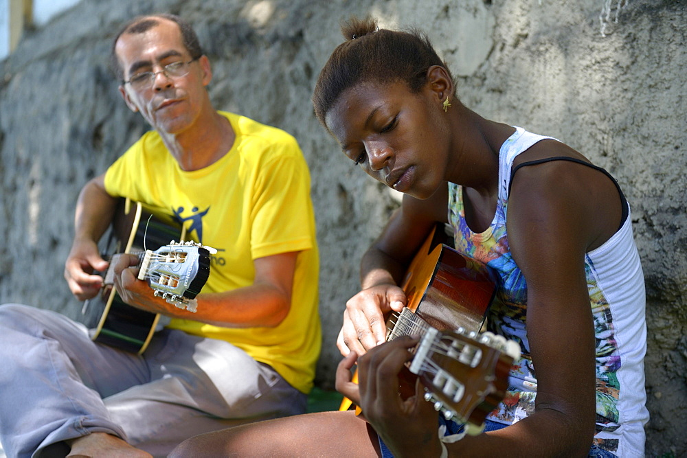 Street child, girl, 15, having guitar lessons with a social worker and musician, Sao Martinho social project, Lapa district, Rio de Janeiro, Rio de Janeiro State, Brazil, South America