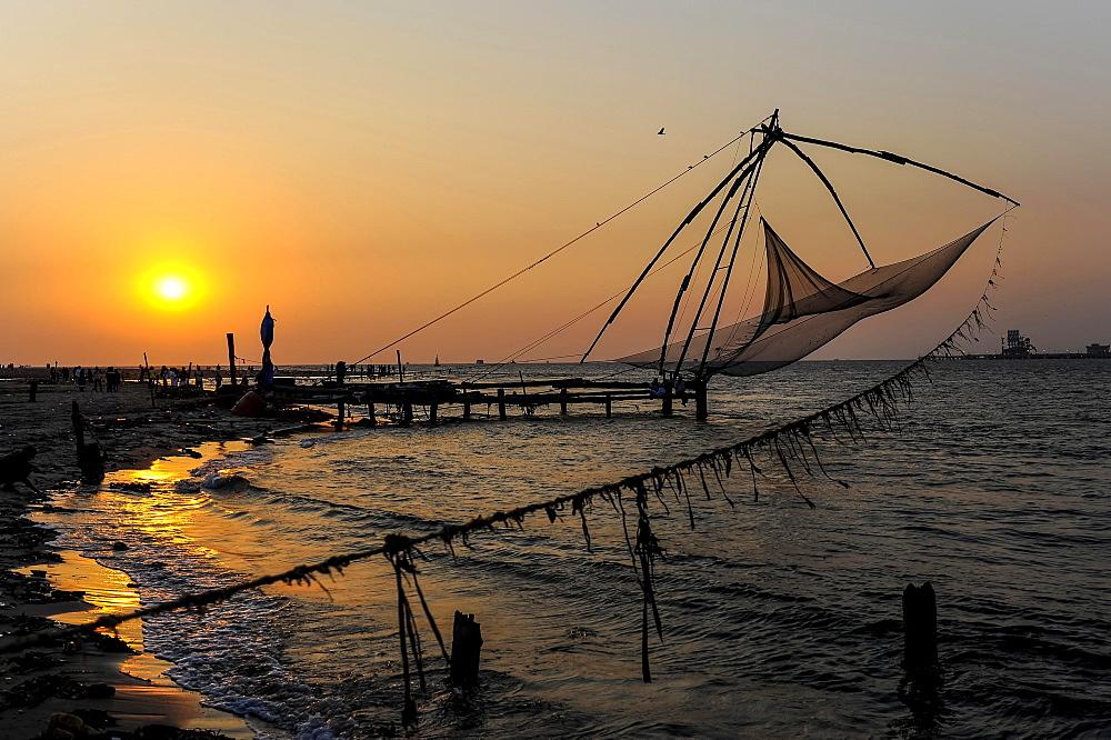 Chinese fishing nets at sunset, Kochi, Kerala, South India, India, Asia - 832-383308