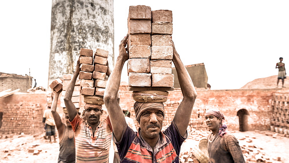 Workers with bricks on their heads in the brickyard, Dhaka, Bangladesh, Asia - 832-383355