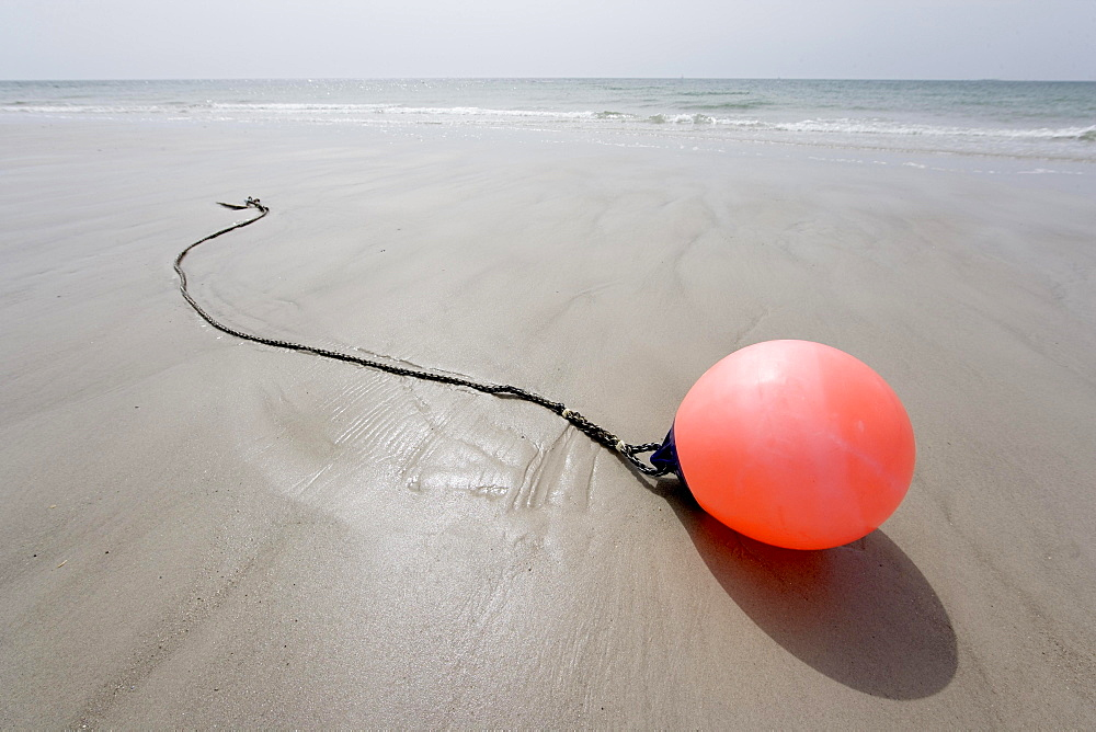 Buoy lying on the beach, Schleswig-Holstein, Germany, Europe