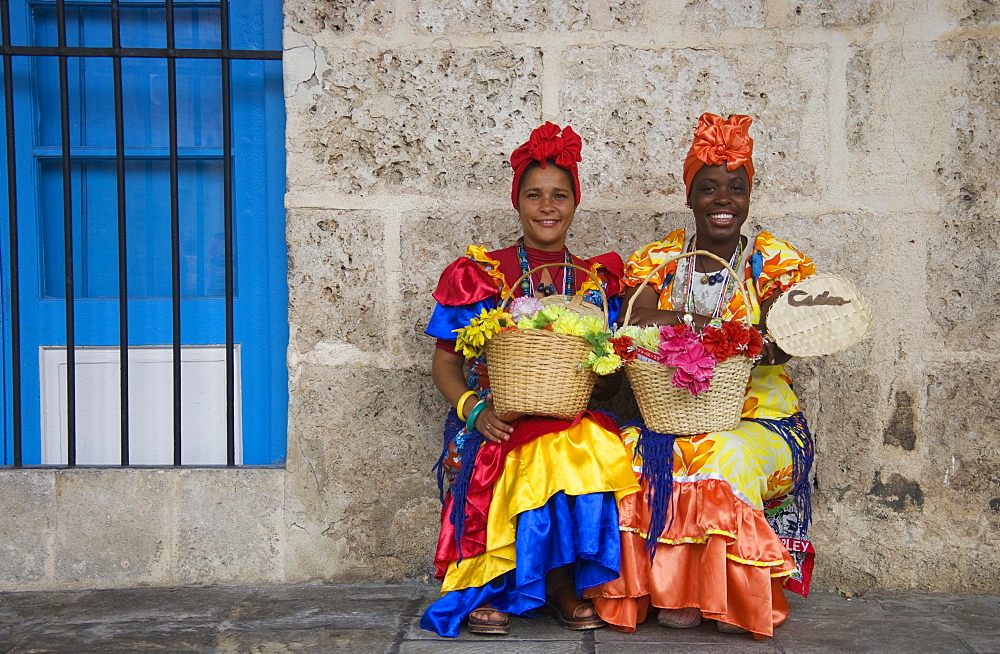 Two women wearing colourful dresses, Havana, Cuba, Central America