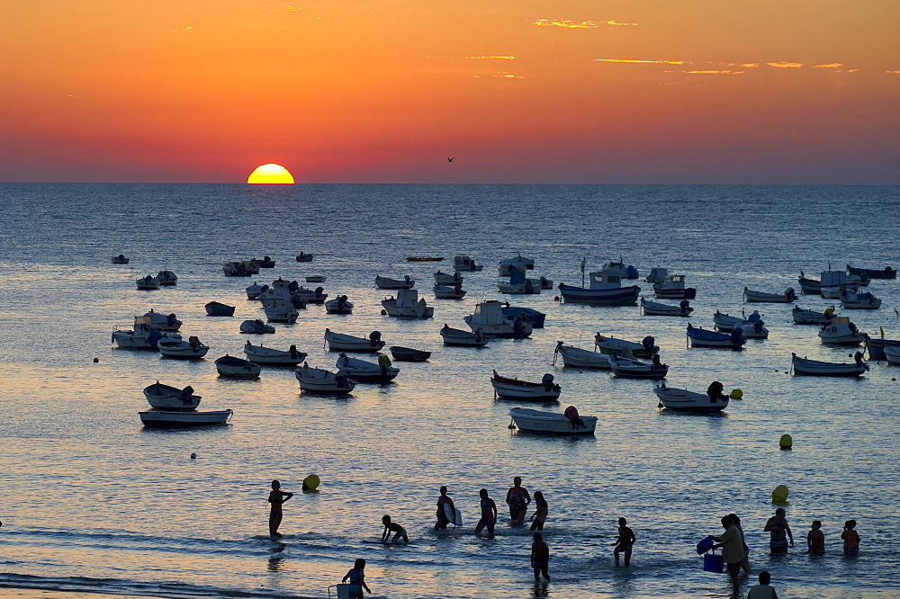 Fishing boats on the ocean at sunset, Cadiz, Andalusia, Spain, Europe