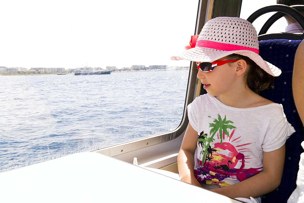 Girl, seven years old, on holiday boat trip, France, Europe