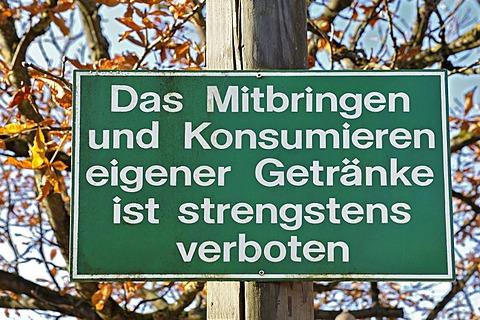 """Prohibition sign """"Das Mitbringen und Konsumieren eigener Getraenke ist strengstens verboten"""", German for """"consumption of drinks not bought on these premises is strictly forbidden"""", MichaeliGarten beer garden in the autumnal Ostpark, Ramersdorf, Munich, Ba"""