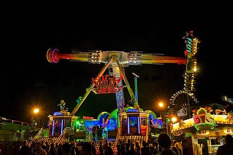 Oktoberfest, Wiesn, amusement rides, giant rotating pendulum at night, Munich, Bavaria, Germany, Europe