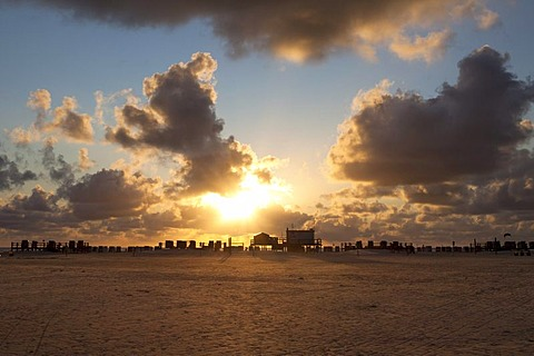 Silhouette of stilt houses on the beach of St. Peter-Ording at sunset, Sankt Peter-Ording, North Friesland district, Schleswig-Holstein, Germany, Europe