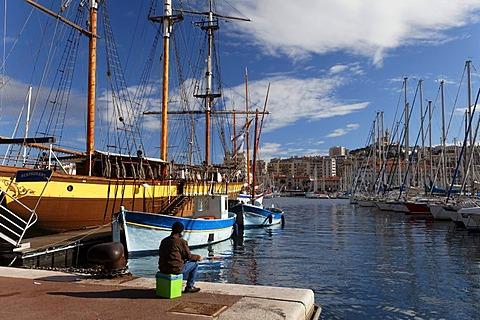 Vieux Port, old port of Marseille, church of Notre Dame de la Garde at back, Bouches-du-Rhone, Provence, France, Europe