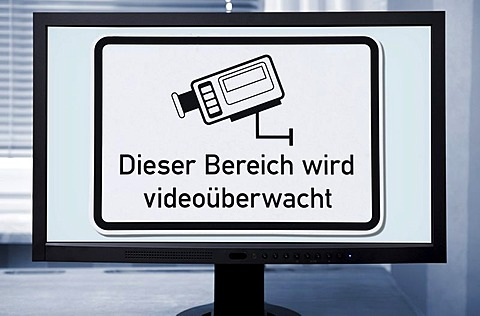 "Sign ""Dieser Bereich wird videoueberwacht"", German for ""this area is under video surveillance"", on a computer screen"