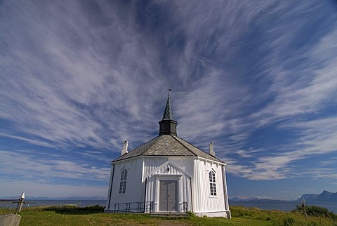 The white wooden octagonal church of Dverberg against a cloudy sky, on the island of Andoya, Andoya, part of the archipelago of VesterÂlen, Vesteralen, Nordland, Norway, Europe