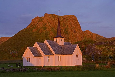 Wooden stave church illuminated by the first light of the day, Langenes, at the northern tip of the island of Langoya, Langoya, part of the archipelago of VesterÂlen, Vesteralen, Nordland, Norway, Europe