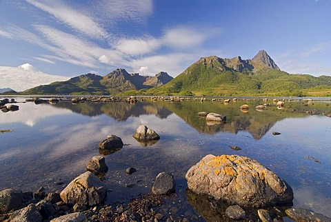 Reflections of the mountains on the island of Langoya, Langoya, part of the VesterÂlen, Vesteralen archipelago, Nordland, Norway, Europe