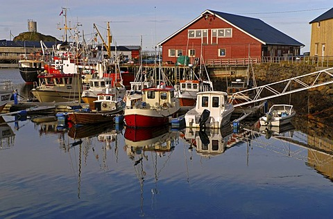 Boats and their reflections in the harbor of Sto, Sto, on the island of Langoya, Langoya, part of the VesterÂlen, Vesteralen archipelago, Nordland, Norway, Europe
