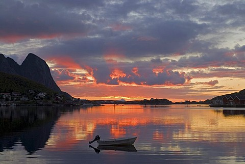 Sunrise with a small boat near Reine, island of Moskenesoy, Moskenesoy, Lofoten archipelago, Nordland, Norway, Europe